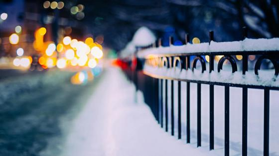 Snowy street with bokeh lights wallpaper