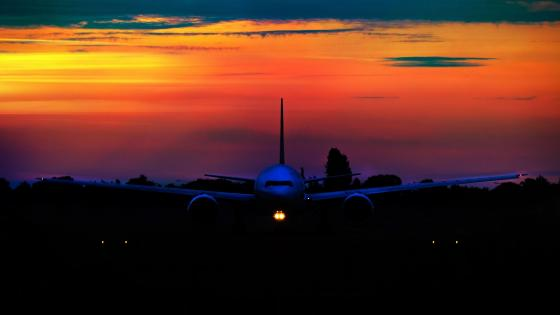 Airplane in the sunset wallpaper
