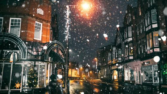 Snowfall in a town wallpaper