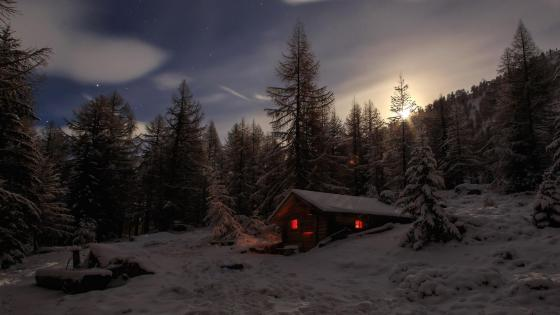 Cabin in the snowy forest wallpaper