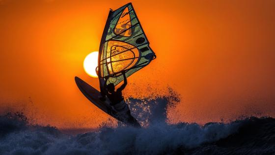 Windsurfing in the sunset wallpaper