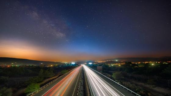 Milky way over the highway wallpaper