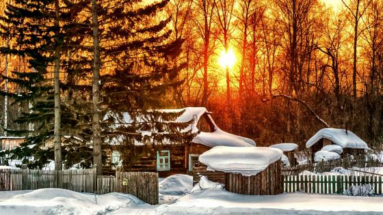 Snowy log cabin wallpaper