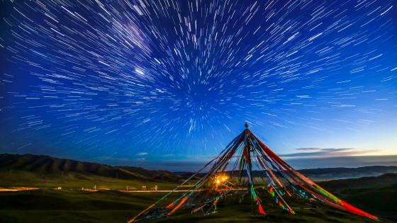 Prayer flags and star trails wallpaper
