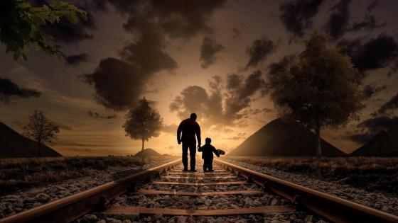 Father and son walking the railroad wallpaper