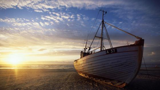 Boat on the beach wallpaper