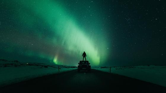 Man under the polar lights wallpaper