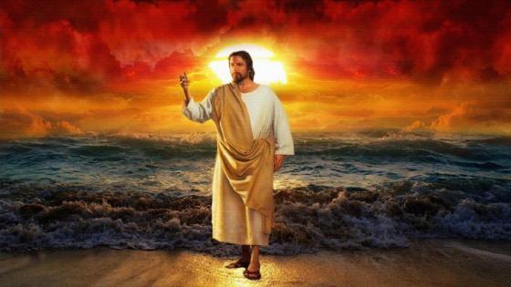 Jesus Christ blessing on sea shore at sunset wallpaper