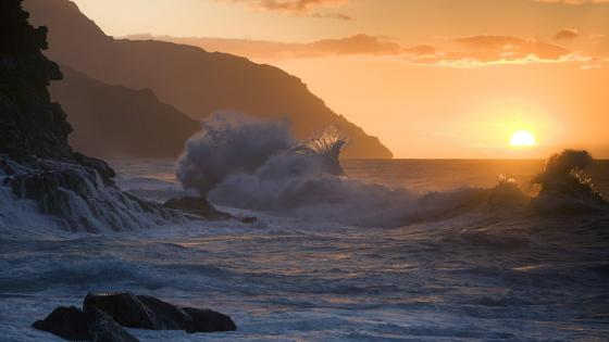 The rugged Napali coastline of Kauai, Hawaii at sunset wallpaper