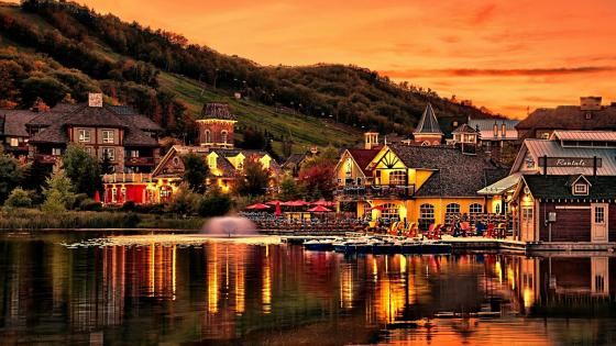 Lakeside village at sunset wallpaper