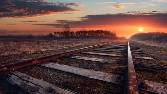 Old railroad in the sunset wallpaper