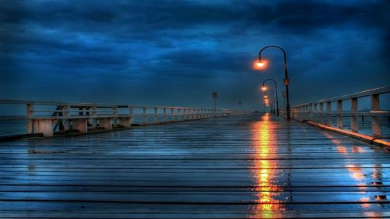 Long pier on a rainy day wallpaper