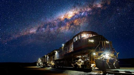 Train under the Milky Way wallpaper