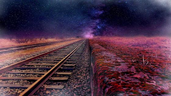 Train rails between night stars wallpaper