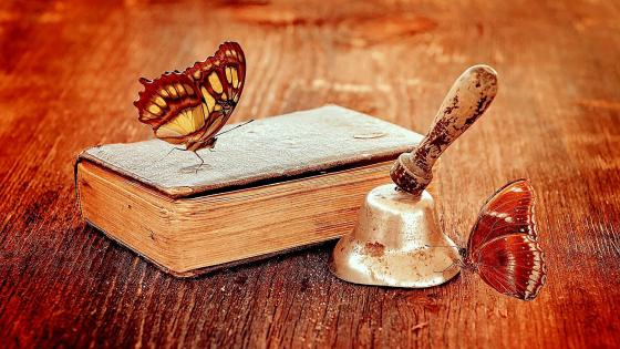 Vintage book and butterflies wallpaper