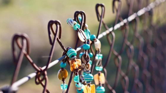 Necklace on the fence wallpaper
