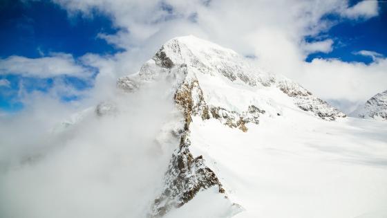Snowy summit wallpaper