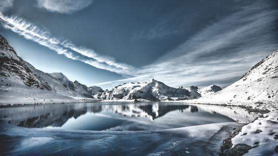Snow capped mountains over the lake wallpaper