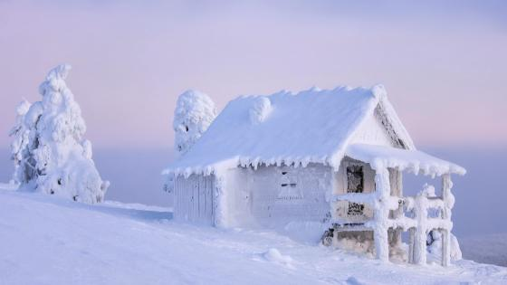 Frozen shanty in mountainside wallpaper