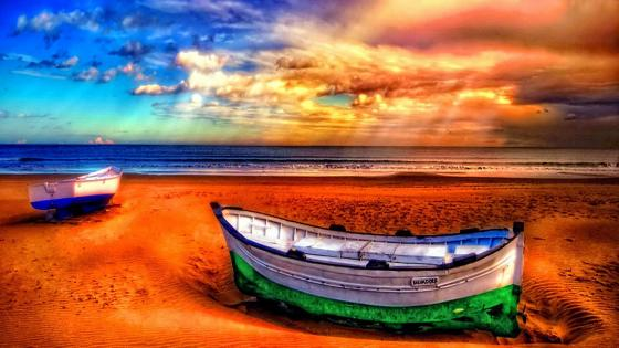 Sandy seascape with boats wallpaper