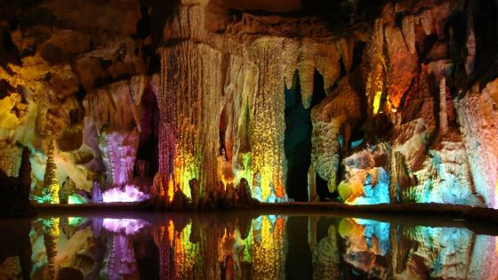 Colorful stalactites in Assembling Dragon Cave wallpaper