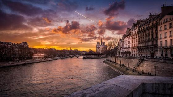 River of Seine and the Notre Dame Cathedral in the distance wallpaper