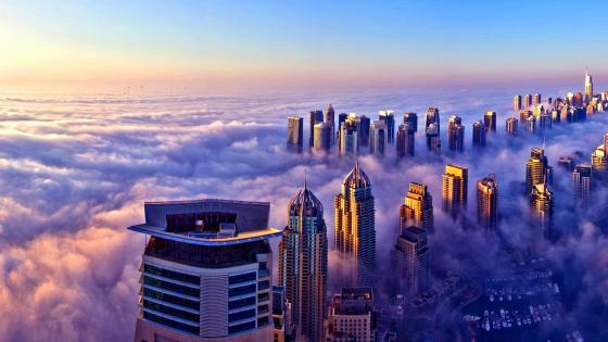 Foggy Dubai skyline from the Burj Khalifa's observation deck wallpaper