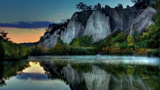 White cliff reflected in the calm lake wallpaper