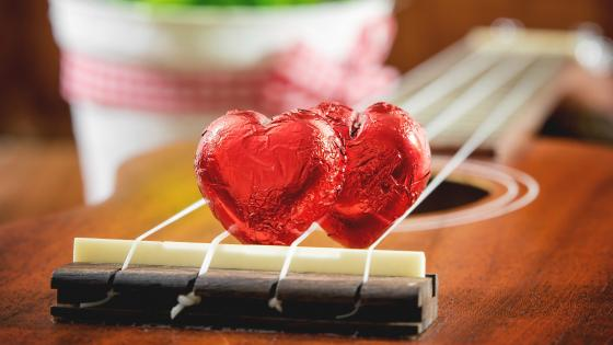 Hearts on a guitar wallpaper