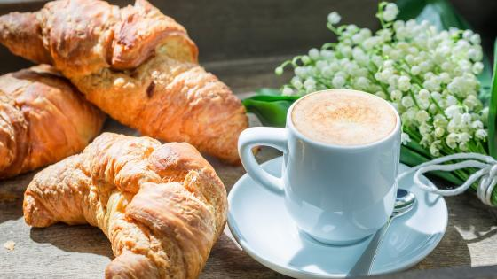 Croissant with coffee for breakfast wallpaper