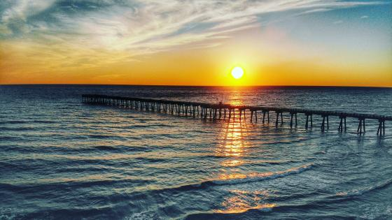 Long pier at sundown wallpaper