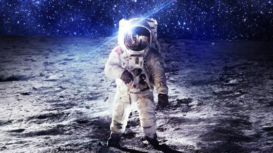Astronaut walking on the Moon wallpaper