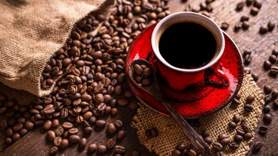 Coffee beans and cup wallpaper