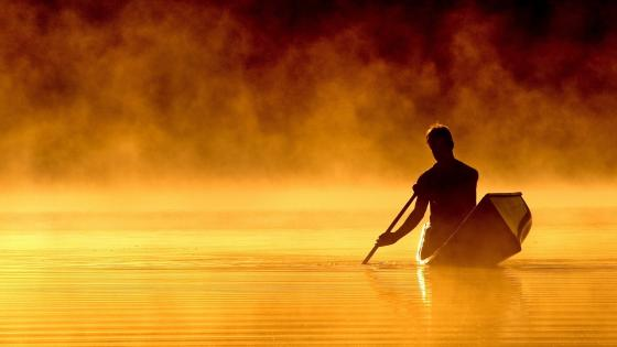Rowing man on a lake wallpaper