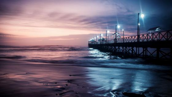Pier in the Huanchaco Beach at dusk (Peru) wallpaper