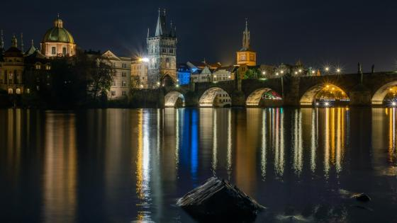 Charles Bridge above the Vltava River at night wallpaper