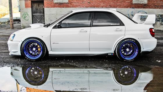 White Subaru reflected in a puddle wallpaper