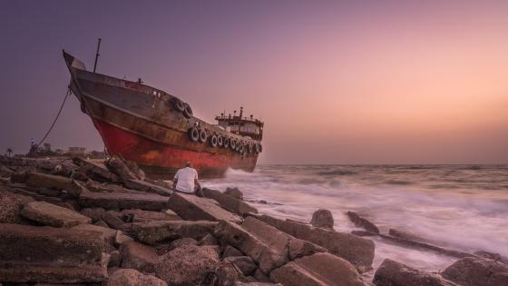 Rusty ship on the shore wallpaper