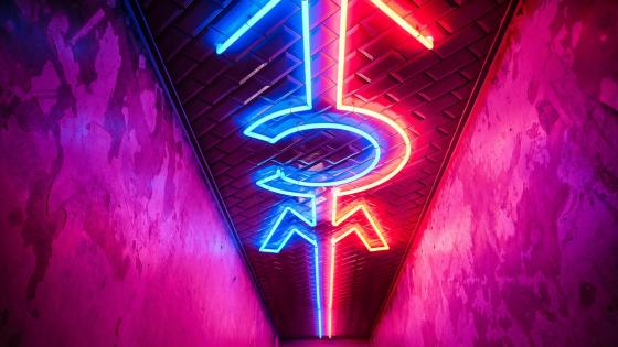 Symbols for a male and female neon sign wallpaper