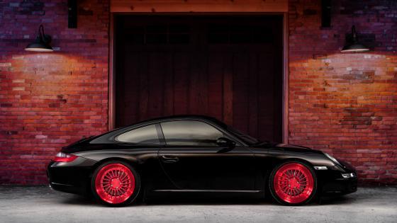 Black Porsche with red rims wallpaper