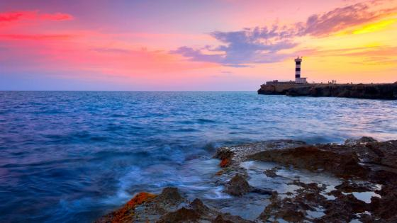 Lighthouse with colorful sky wallpaper