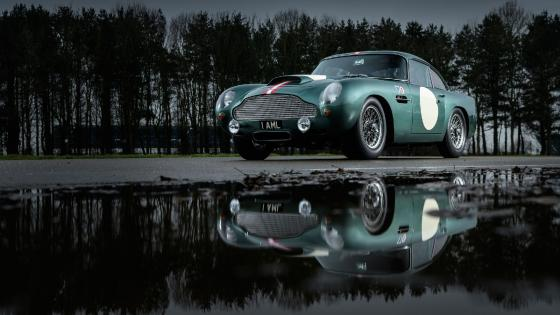 Aston Martin DB4 GT reflected in a puddle wallpaper
