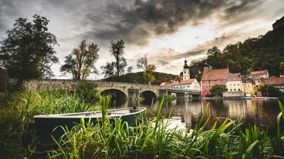 Cozy village next to a river wallpaper