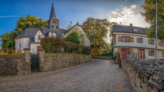 Cobblestone street to church wallpaper