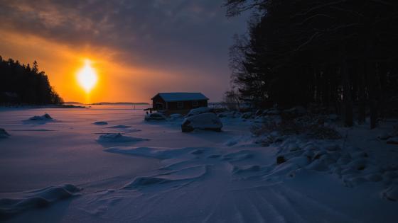 House at a frozen lake wallpaper