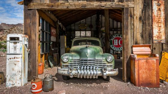 Old gas station with a vintage car wallpaper