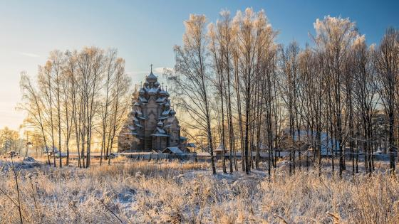 Hoary landscape with a wooden church wallpaper