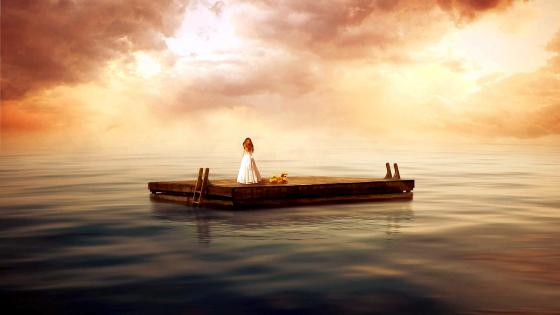 Little girl alone on a raft wallpaper