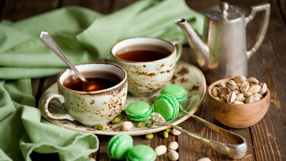 Tea with green macaroons wallpaper