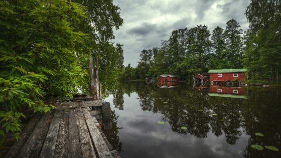 Crumbling red boathouses wallpaper